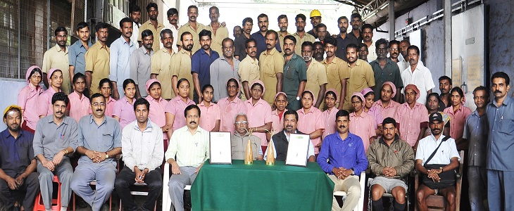 Mr.Jacob Mathew, DGM - Nilgiri Wynad Group and Mr.V.M.Madhavan, Sussex Tea Factory-Manager with the 'Golden Leaf India Awards' awarded to Sussex for best CTC Fannings and CTC Dust with the Executives, Staffs and Workers of Sussex Estate & Factory